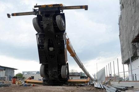 Mobile crane topples over