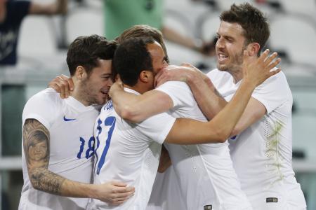 Mystery face on England midfielder's arm