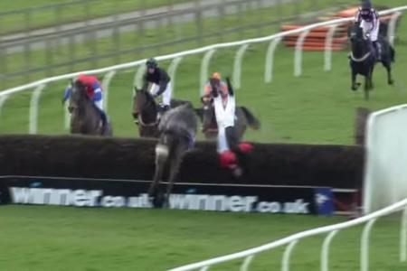 WATCH: Amateur jockey falls off horse, hits fence & somersaults in air, then walks away