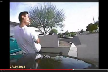 Arizona police use car to ram into suspect with gun