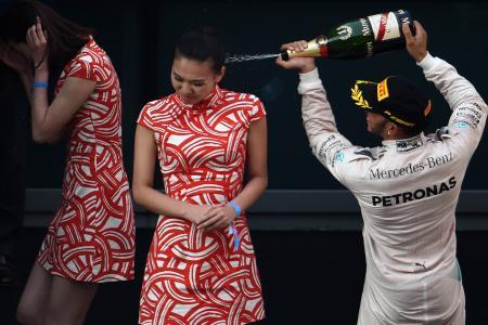 Lewis Hamilton slammed for spraying champagne on hostess. She says...