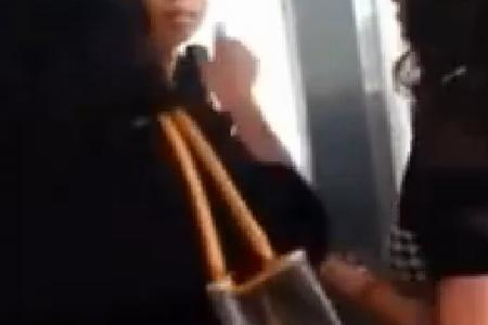 Women spit, slap and splash drink on condo staff member