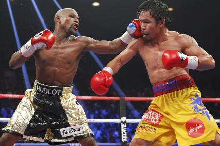 Mayweather brands Pacquiao a 'coward' and 'sore loser'