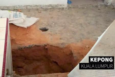 Cops arrest parents of boy buried in kitchen