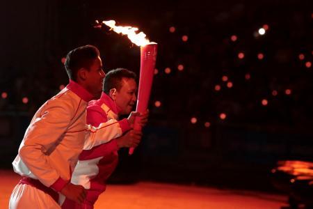 Fandi and son light SEA Games flame