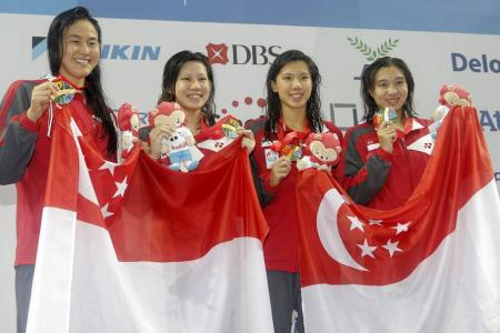 S'pore swimmers clinch two golds on first day