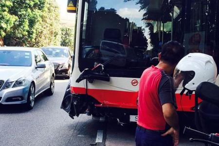 Bus collides with cab, 2 injured