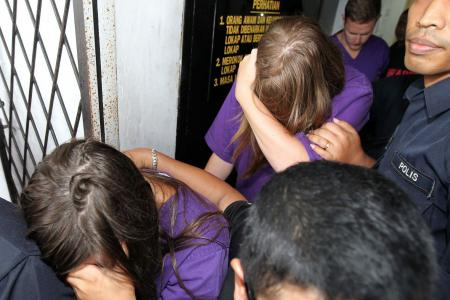Foreigners plead guilty of stripping on Mt Kinabalu