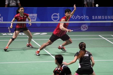Malaysia and Indonesia share badminton spoils on exciting final day