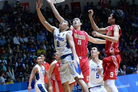 Philippines survive stern test to earn basketball gold