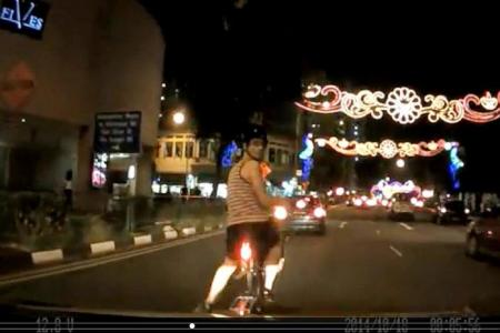 Man fined for throwing bicycle on car that hit him