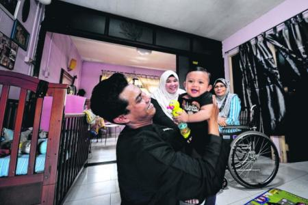 Do-it-all dad: He's caregiver to wheelchair-bound wife & 10-month-old son