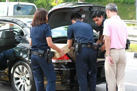 Man in BMW full of illegal curry puffs, kueh fails to stop at Tuas checkpoint