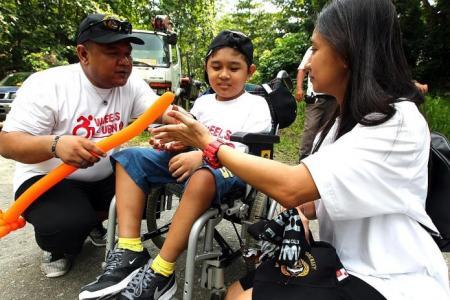 100 people in wheelchairs visit Pulau Ubin