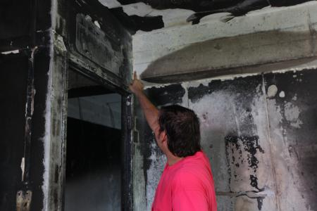 After fire, he sleeps at staircase landing out of guilt