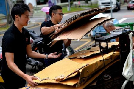 Youths learn why the elderly collect cardboard