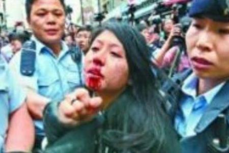 Hong Kong woman convicted of hitting police officer with her breast