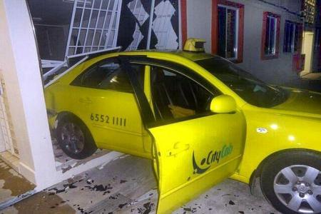 Taxi reverses into HDB flat, knocking down wall