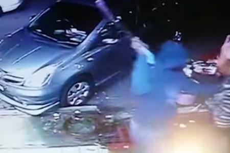 WATCH: Knife-wielding men rob M'sia eatery