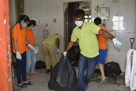 Cleaning out Jurong West hoarders' flats