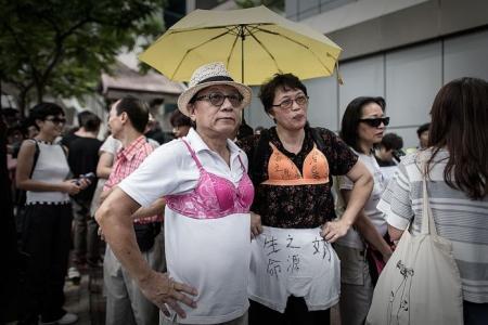 100 join 'breast walk' protest in HK