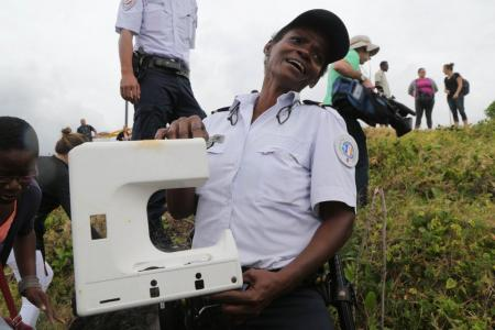 MH370 window frame or sewing machine part? Speculation rises over Reunion Island debris