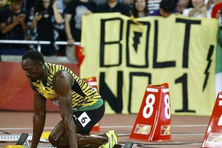 Bolt and Gatlin cruise into 100m semi-finals at Worlds