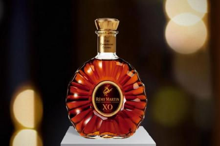 Why did woman down $280 cognac just before flying?