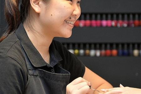 Manicurist earns accountant's wage thanks to ringgit plunge