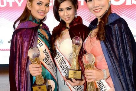 Beauty with braces smiles her way to Miss Singapore title