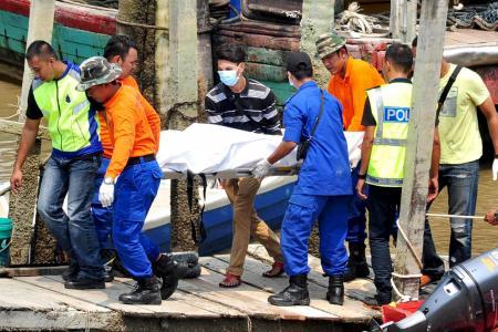 Boat capsizes off Malaysia killing 13 women, 1 man