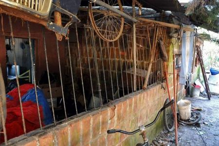Man locks wife, son in cage for years