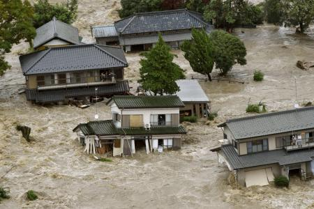 Japanese city flooded as raging river breaks its banks