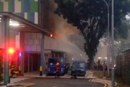 Raging fire at Ubi warehouse