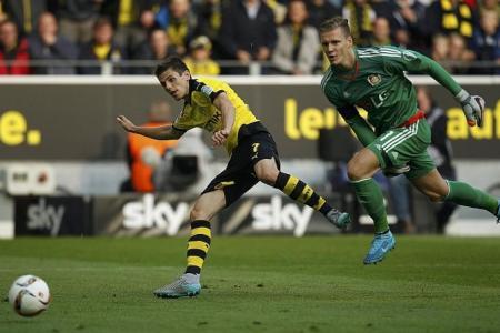 New coach Tuchel inspires Borussia Dortmund to 11th straight win