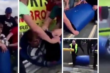 WATCH: Grimsby fans celebrate win by pushing a friend down the stairs in a bin