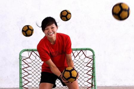 Yuhua Secondary's tchoukball teacher-coach Lim is tough on discipline