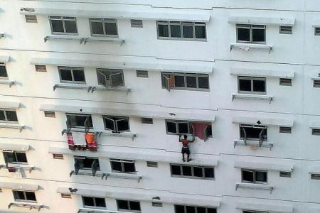 VIDEO: Man climbs out to ledge to escape Buangkok fire