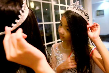 Girl, 8, wins beauty pageant after beating cancer