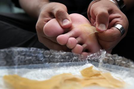 Art and sole: Singapore artist sculpts with skin from his feet