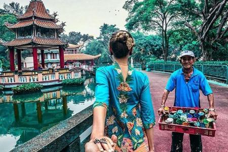 Photographer's photo of wife wearing kebaya top backwards draws online flak