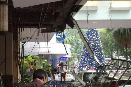 Driver and boss escape Hilton hotel driveway ceiling collapse by mere seconds