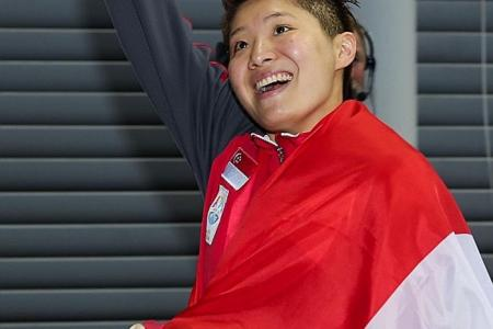 Swim star Tao Li opens coaching academy