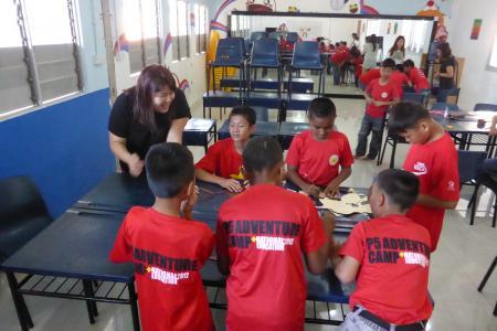 Volunteering to teach children English, life skills