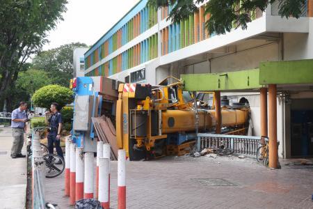 Crane crashes into Woodlands building
