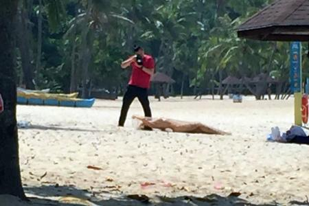 Model stopped while posing nude on Sentosa beach