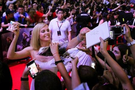 Teen fan feels faint after hugging Charlize Theron