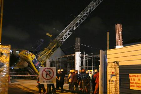Crane topples: 'Boom could have cut building in half'