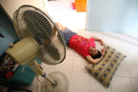 Couple sleep on bare floor to keep cool