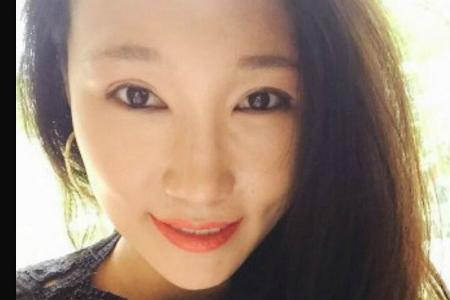 Woman, who swam topless, jailed for attacking cops at Sentosa